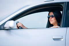 Beautiful young woman driving a car Stock Image