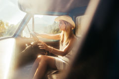 Beautiful young woman driving a car on sunny day Royalty Free Stock Photos