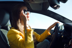 Beautiful young woman driving her car. Royalty Free Stock Photo