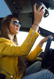 Beautiful young woman driving her car. Stock Images