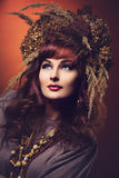 Beautiful young woman with dry flowers on head Royalty Free Stock Photos