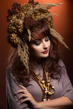 Beautiful young woman with dry flowers on head Stock Photo