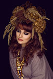 Beautiful young woman with dry flowers on head Royalty Free Stock Photo
