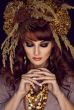 Beautiful young woman with dry flowers on head Stock Images