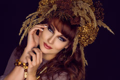Beautiful young woman with dry flowers on head Royalty Free Stock Image