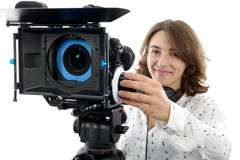 Beautiful young woman with DSLR video camera Stock Image