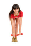 Beautiful young woman with dumbbells. Isolated against white background Royalty Free Stock Photography