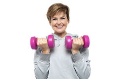Beautiful young woman with dumbbells. Isolated against white background Royalty Free Stock Images