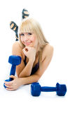 Beautiful young woman with dumbbells. Isolated against white background Stock Photos