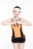 Beautiful young woman with dumbbells. Beautiful chinese girl working out with dumbbells over white background Stock Photo