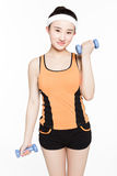 Beautiful young woman with dumbbells. Beautiful chinese girl working out with dumbbells over white background Royalty Free Stock Photos