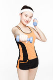 Beautiful young woman with dumbbells. Beautiful chinese girl working out with dumbbells over white background Royalty Free Stock Images