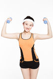Beautiful young woman with dumbbells. Young sporty asian woman training with the dumbbell Stock Image