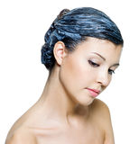 Beautiful young woman dyeing hairs Stock Photography