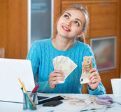 Beautiful young woman earning money being freelancer Royalty Free Stock Image