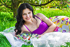 Beautiful young woman with easter eggs in the garden Royalty Free Stock Image