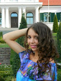 Beautiful young woman, from Eastern Europe, Romania posing and e. Beutiful young woman, from Eastern Europe, Romania, enjoying herself and beeing happy while Royalty Free Stock Photo