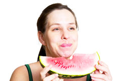 Beautiful young woman eat juicy watermelon Stock Images