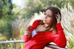 Beautiful young woman eating apple. Stock Photos