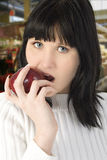 Beautiful Young Woman Eating Apple royalty free stock photography