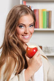 Beautiful young woman eating apple Royalty Free Stock Photo