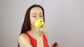 Beautiful young woman eating an apple stock video footage