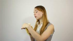 Beautiful young woman eating banana stock video footage