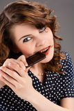 Beautiful young  woman eating chocolate Royalty Free Stock Photos