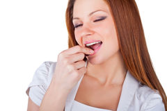 Beautiful young woman eating chocolates Royalty Free Stock Photo