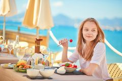 Beautiful young woman eating fruits Royalty Free Stock Image