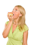 Beautiful young woman eating a green apple. Isolated over white Stock Photos