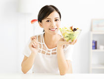 Beautiful  young woman eating healthy food Stock Image
