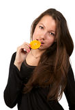 Beautiful young woman eating orange Stock Images