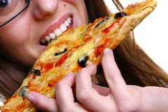 Beautiful young woman eating pizza Stock Photography