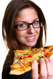 Beautiful young woman eating pizza Stock Photo