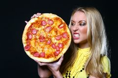Beautiful young woman eating pizza Stock Image