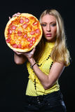 Beautiful young woman eating pizza Royalty Free Stock Photo