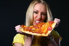 Beautiful young woman eating pizza Royalty Free Stock Photography