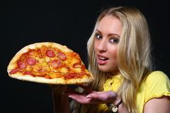 Beautiful young woman eating pizza Royalty Free Stock Photos