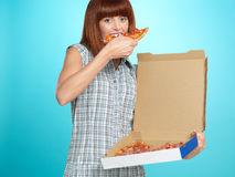 Beautiful young woman eating a pizza pie Stock Photography
