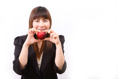Beautiful young woman eating red apple Royalty Free Stock Photos