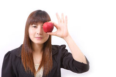 Beautiful young woman eating red apple Stock Photos