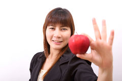 Beautiful young woman eating red apple Stock Photo