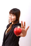 Beautiful young woman eating red apple Royalty Free Stock Photo