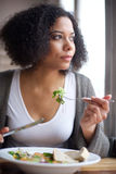 Beautiful young  woman eating salad at restaurant Stock Photo