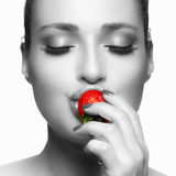 Beautiful Young Woman Eating Strawberry Stock Images