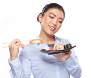 Beautiful young woman eating sushi. Stock Photo