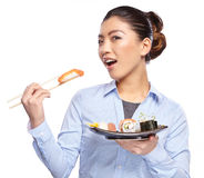 Beautiful young woman eating sushi. Royalty Free Stock Photography