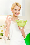 Beautiful young woman eating vegetable salad Stock Images