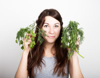 Beautiful young woman eating an vegetables. holding dill and parsley. healthy food - healthy body concept Stock Image